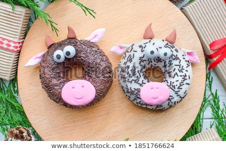New Year's cupcakes with chocolate glaze Stock photo © dimga