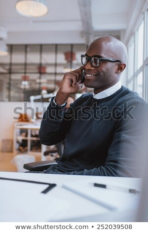 Stock photo: Happy Man Answering Cell Phone While Looking Away