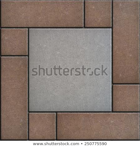 Brown Figured Paving Slabs - Rectangles and Squares. Stock photo © tashatuvango