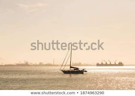 Lonely sailboat in the morning mist Stock photo © CaptureLight