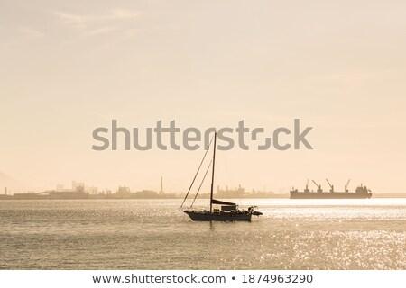 Yalnız yelkenli sabah buğu okyanus Stok fotoğraf © CaptureLight