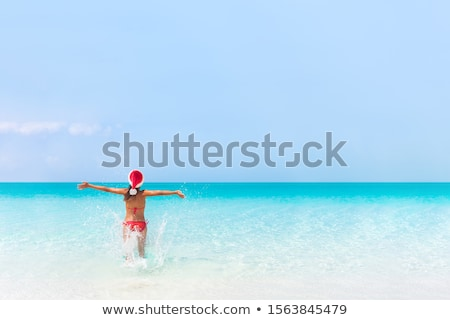 Stock photo: Christmas beach woman in santa hat on holidays