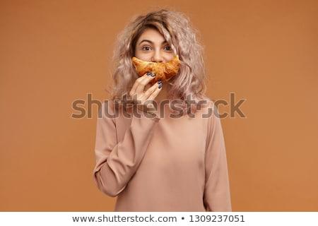 Kobieta rogalik piękna młoda kobieta patrząc jak Zdjęcia stock © svetography