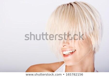Blond model with a modern hairtyle Stock photo © majdansky