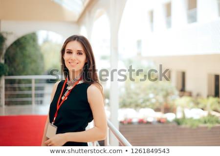 Anfitriã mulher jovem de mãos dadas quadris retrato Foto stock © filipw