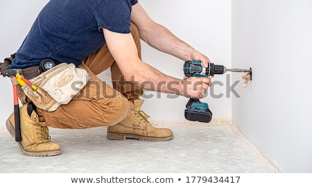 Stok fotoğraf: Electrician With Drill And Cable