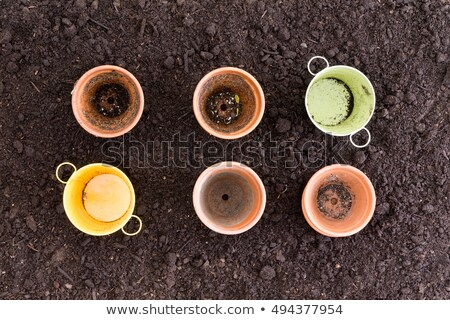 Four clay pots and two metal ones in rows of three Stock photo © ozgur