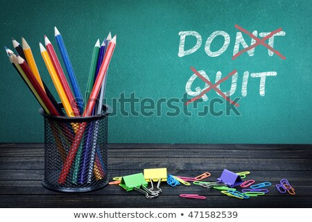Dont quit text on green board Stock photo © fuzzbones0