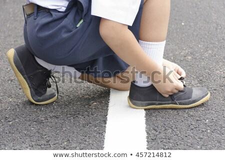 Dziecko student buty przydrożny ręce sportu Zdjęcia stock © Bigbubblebee99