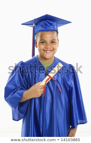 Boy in blue graduation gown Stock photo © bluering