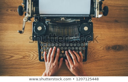 Typing with old typewriting machine Stock photo © carenas1