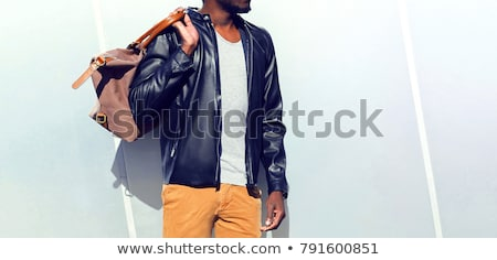 Hipster in profile over gray background Stock photo © deandrobot