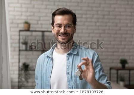 Agent immobilier clé nouvelle femme d'affaires isolé Photo stock © mmarcol