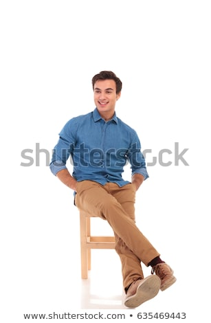 happy seated man with hands in pockets is laughing Stock photo © feedough