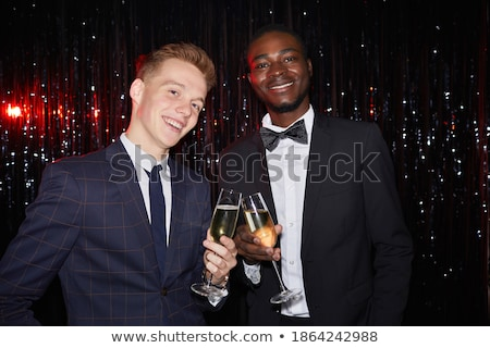 portrait of smiling friends standing at nightclub stock photo © wavebreak_media