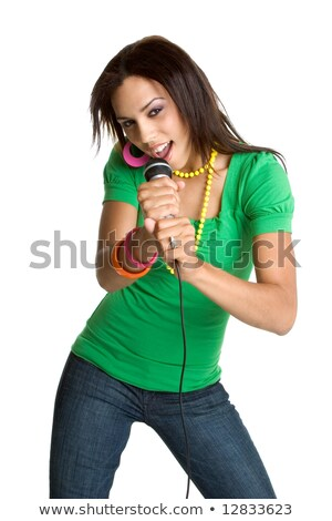 Portrait of young female singer with hand on hip and mic at nightclub Stock photo © wavebreak_media
