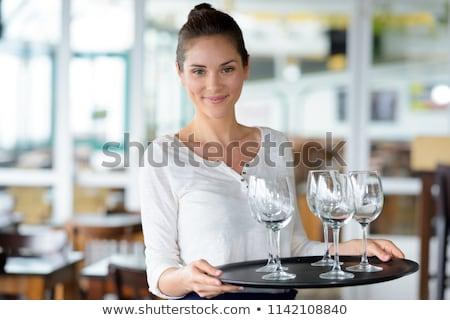 Gülen garson gözlük şarap tepsi Stok fotoğraf © wavebreak_media