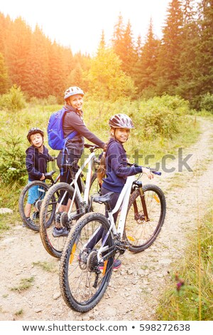 Girl cycling in Forest Stock photo © IS2