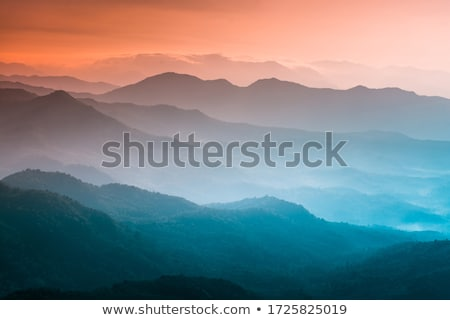 nature landscape background with silhouettes of mountains and trees vector illustration stock photo © leo_edition