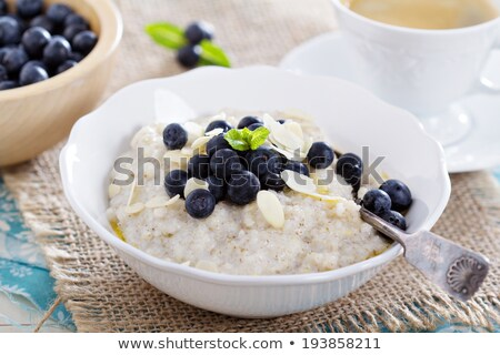 bowl of barley porridge and spoon isolated healthy food for bre stock photo © maryvalery
