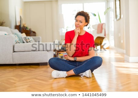 portrait of a young casual woman sitting with hands crossed stock photo © feedough