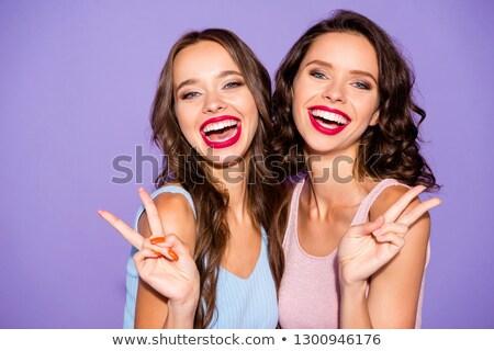 Boldog nő piros ajkak mutat béke kézmozdulat Stock fotó © deandrobot