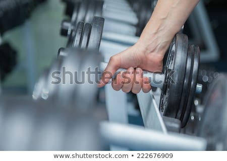 close up of man with dumbbells exercising Stock photo © dolgachov