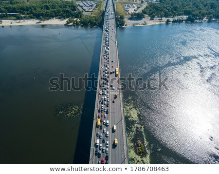 Traffic on a road in north bridge over the Dnieper River of Kiev. Stock photo © artjazz