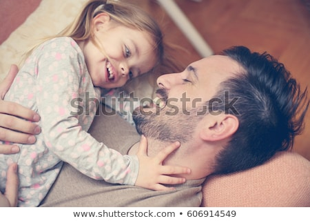 Cheerful father spending fun time with his little daughter Stock photo © deandrobot