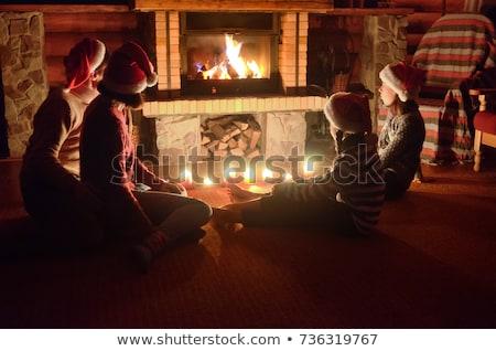Mikulás ül kandalló új év nappali ünnepel Stock fotó © jossdiim