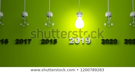 2019 new year sign under light bulbs stock photo © mikhailmishchenko