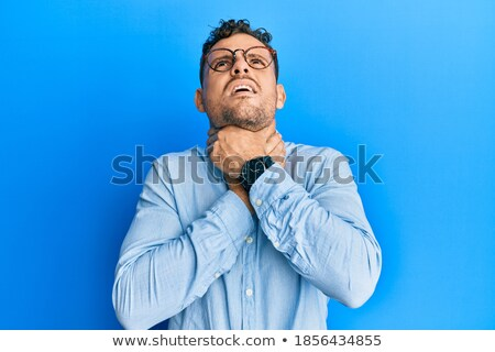 portrait of young smart casual man holding palms together stock photo © feedough