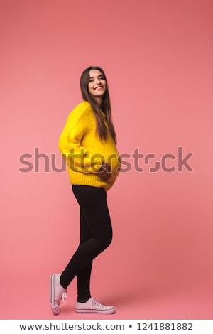 ストックフォト: かわいい · かなり · 若い女性 · ポーズ · 孤立した · ピンク