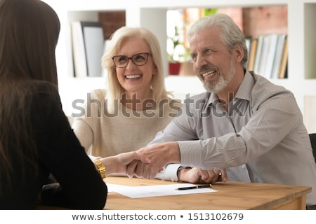 happy old woman shaking hands with friendly health insurance broker stock photo © diego_cervo