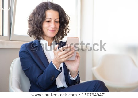 Stock photo: woman looking at smartphone