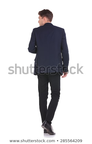 side view of elegant man walking while looking back Stock photo © feedough