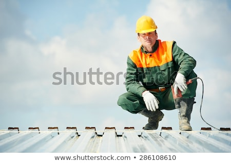 Worker Installing Wall Tile at Construction Site Stock photo © feverpitch