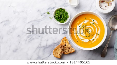 pumpkin soup in white plate with fresh pumpkins stock photo © melnyk