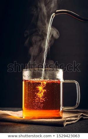 Sıcak içecek fincan kahve el tablo çay Stok fotoğraf © ra2studio