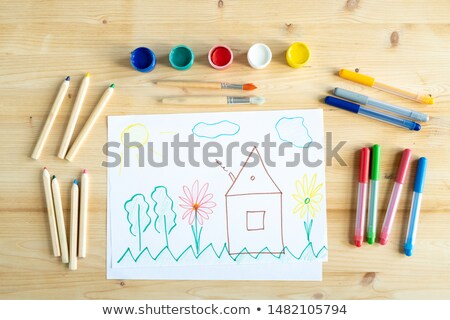 Colorful paints, crayons and paintbrushes over pencil drawing Stock photo © pressmaster