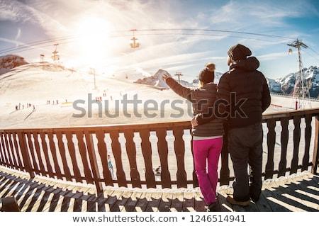 Family on a ski slope at sunset. Stock photo © ConceptCafe