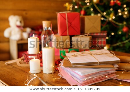Stack of Christmas letters, burning candles and pile of giftboxes Stock photo © pressmaster