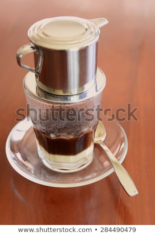 Phin Traditional Vietnamese Coffee Maker Place On The Top Of Glass Add Ground Coffee Then Pour H Stock Photo C Elizaveta Galitckaia Galitskaya 10045484 Stockfresh