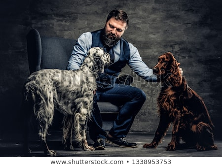 The hunter with a dog against a dark background Stock photo © mayboro