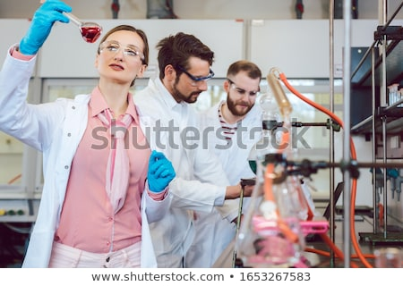 Three analytical chemists doing research in the lab Stock photo © Kzenon