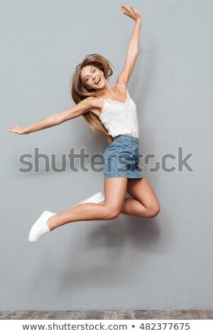 Une fille heureuse gris jupe illustration femme Photo stock © bluering
