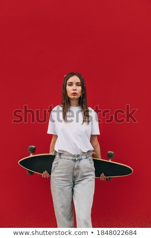 Woman holding longboard isolated on a white background. Back view Stock photo © Lopolo