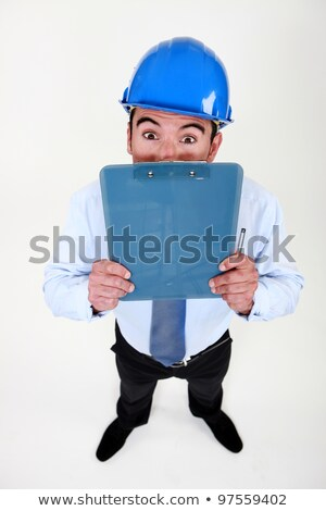 Surveyor peering over his clipboard Stock photo © photography33