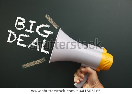 Business deal written on a blackboard background with handshaking Stock photo © bbbar