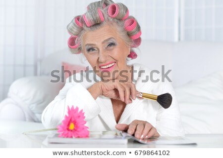 Senior woman with hair curlers Stock photo © photography33
